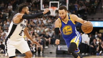 Stephen Curry dribbles the ball as Patty Mills defends during the second half in Game 4 of the Western Conference finals.