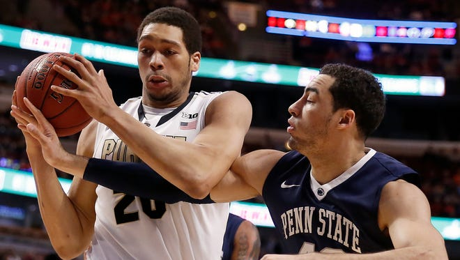 Purdue's A.J. Hammons (20) grabs a rebound against Penn State's Ross Travis (43) in the first half of an NCAA college basketball game in the quarterfinals of the Big Ten Conference tournament, Friday, March 13, 2015, in Chicago. (AP Photo/Charles Rex Arbogast)
