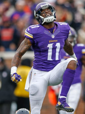 Minnesota Vikings wide receiver Mike Wallace (11) celebrates his catch against the Chicago Bears in the second quarter at TCF Bank Stadium.