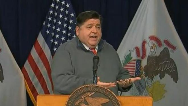 Gov. JB Pritzker speaks at his daily COVID-19 briefing in Chicago on Monday.
