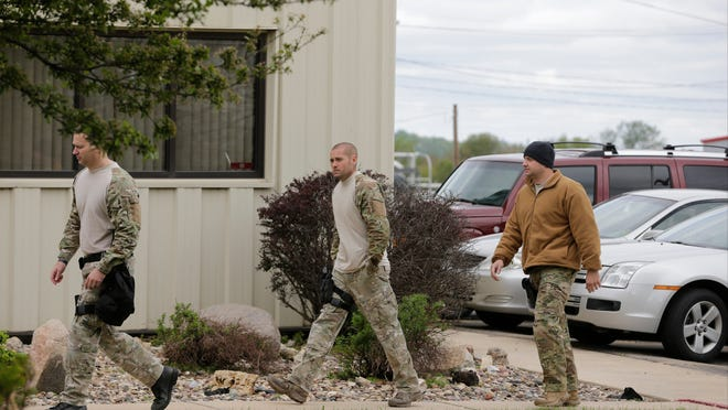 Law enforcement officials at Midamar, 1105 60th Avenue SW, during a federal investigation in southwest Cedar Rapids, Iowa, on Tuesday, May 12, 2015. (Jim Slosiarek/The Gazette)