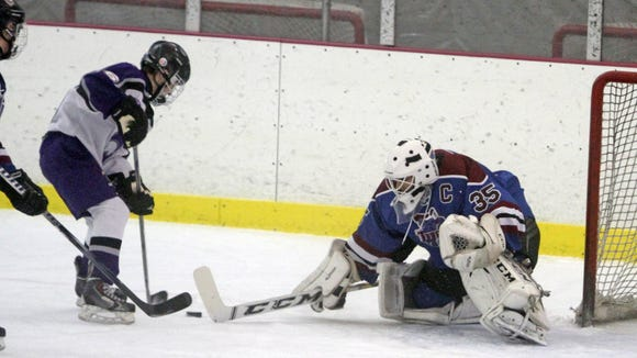 Rye Town/Harrison goalie Joey Livornese makes a save during Friday's game.