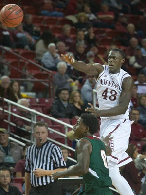 New Mexico State forward Pascal Siakam pushes the ball up court with an aggressive outlet pass over Mississippi Valley State's Vacha Vaughn during first half action Saturday night at the Pan American Center.