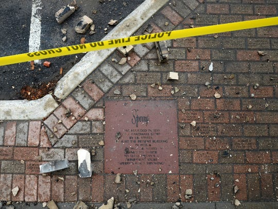A sidewalk stone commemorating the history of Sperry's