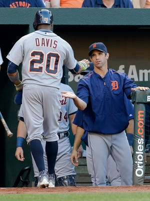 Brad Ausmus greets Rajai Davis after Davis scored on a single by Ian Kinsler in the first inning Friday night.