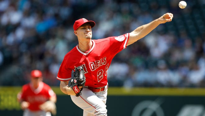 Los Angeles Angels pitcher Andrew Heaney throws a pitch in the first inning against the Seattle Mariners at Safeco Field.