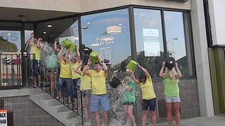 The crew does the dousing for the ALS ice bucket challenge at the Denville branch of Highlands State Bank.