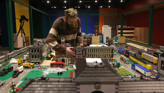 James Kavanaugh, with OKILUG, the Ohio, Kentucky, Indiana LEGO Users Group, puts together a city made entirely of LEGOs.