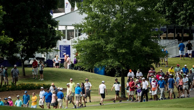 June 12, 2015 - Fans make their way along the 18th hole during the second round of the St. Jude Classic golf tournament at TPC Southwind.(Brad Vest/The Commercial Appeal)