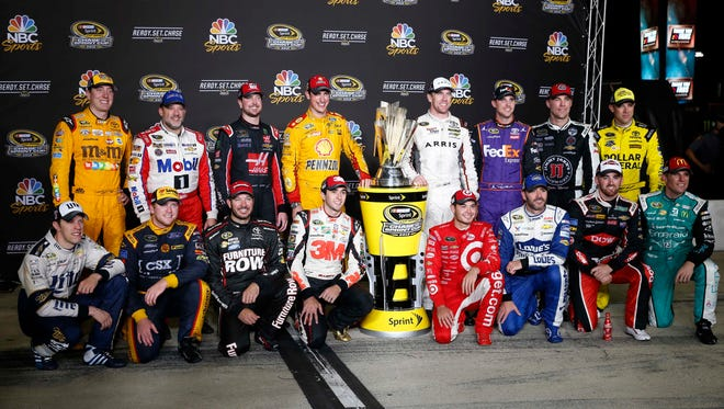 Chase for the Sprint Cup Series drivers pose after the final regular-season race at Richmond International Raceway.