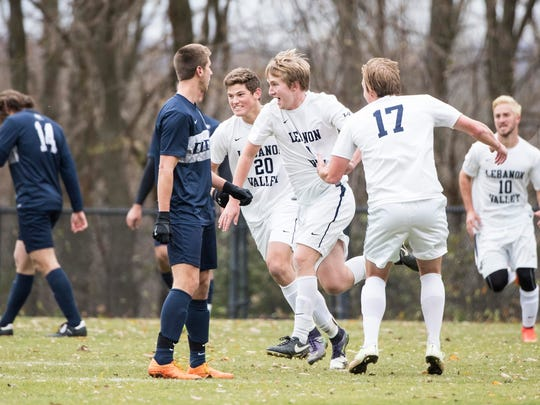 Bradley Mehl, center, is congratulated by Alex Detweiler (17) and Matt Prince (20) after scoring the first LVC goal in a 2-1 win over Drew.