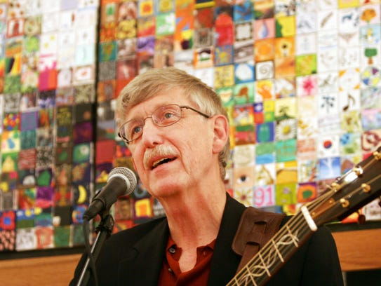 Francis Collins sings a song at the Collins Cooperative