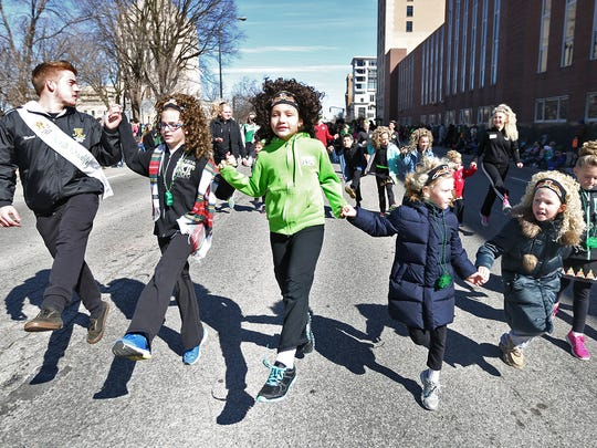 Members of the Richens/Timm Academy of Irish Dance perform on Pennsylvania St., during the downtown Indianapolis St. Patrick's Day Parade, Tuesday, March 17, 2015.
