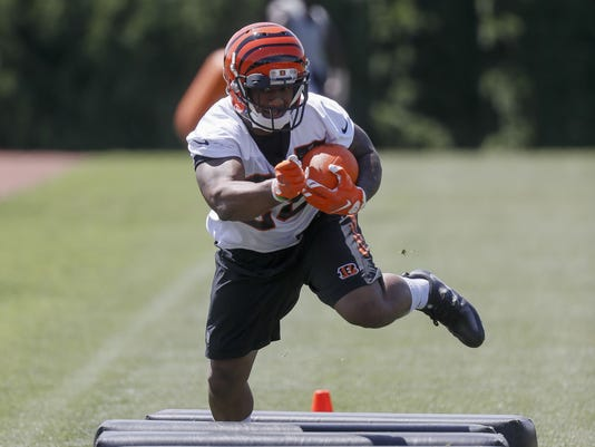 FILE - In this May 23, 2017, file photo, Cincinnati Bengals running back Joe Mixon runs a drill during organized team activities, in Cincinnati. The Bengals signed Mixon to a four-year contract Friday, June 2, 2017. (AP Photo/John Minchillo, FIle)