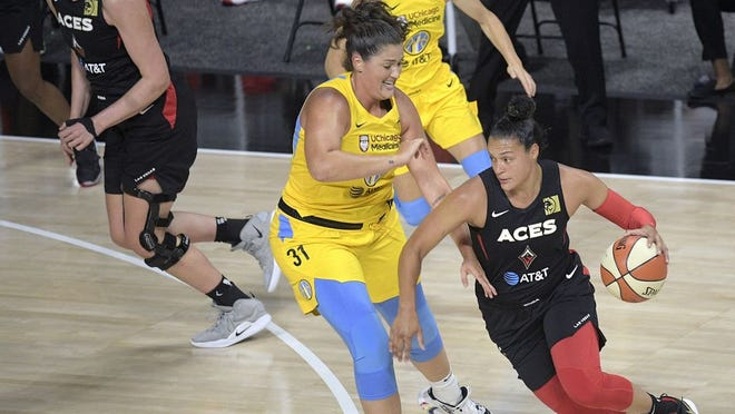 Las Vegas Aces guard Kayla McBride, right, drives past Chicago Sky center Stefanie Dolson (31) during the first half of a WNBA basketball game Sunday in Bradenton, Fla.