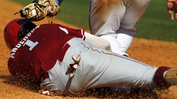 Arkansas' Brian Anderson (1) is called safe as he slides into third base under the tag from Mississippi's Austin Anderson during the fourth inning at the Southeastern Conference NCAA college baseball tournament on Friday, May 23, 2014, in Hoover, Ala. (AP Photo/Butch Dill)