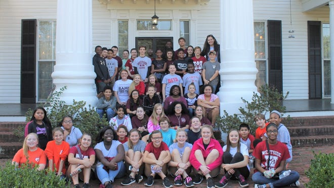 Shown are Robert Anderson Middle School Beta Club students at the historic Marshall Orr House on West Market Street in Anderson.