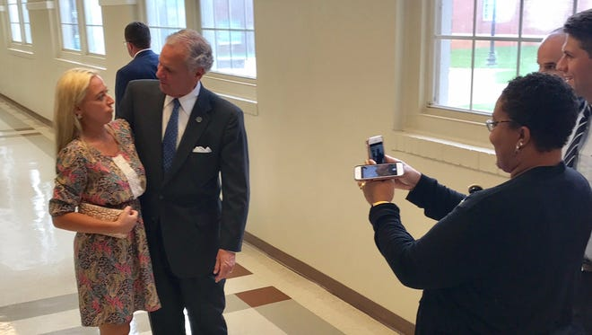 Gov. Henry McMaster posed for pictures with a few dozen of the people who showed up at Gettys Middle School in Easley Tuesday night for an event organized by State Rep. Neal Collins (R-Easley).