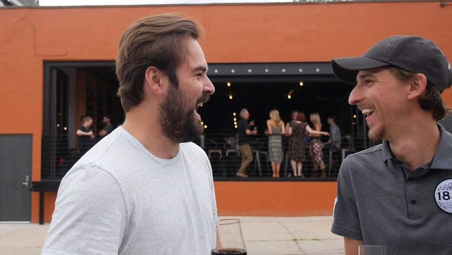 Mike Rooney of SipMilwaukee shares a laugh with Kyle Vetter of 1840. SipMilwaukee introduces SipTrail with breweries and bars.