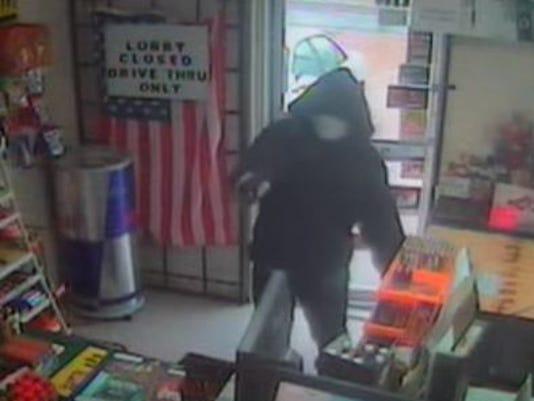 635894941456916061-armed-robber-snip.JPG