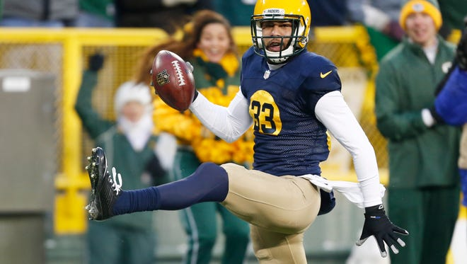 The Eagles' Bradley Fletcher dives after the Green Bay Packers' Jordy Nelson after a 64-yard pass reception during the first half Sunday in Green Bay, Wisconsin.