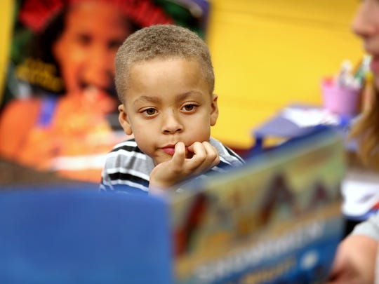 Rayshawn Allen takes part in a reading event in January that's designed to teach and encourage parents to read to their child.