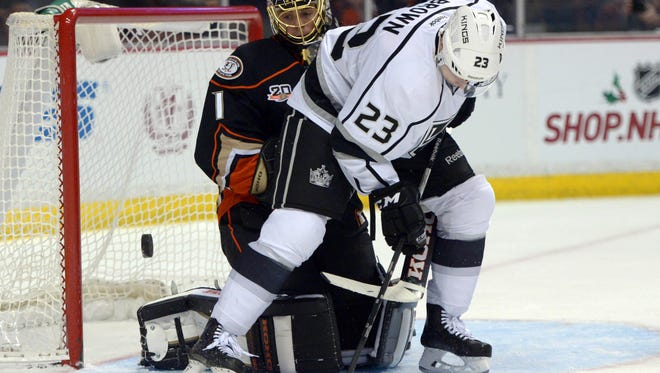 Anaheim Ducks goalie Jonas Hiller (1) defends the goal against Los Angeles Kings right wing Dustin Brown (23) in the first period at Honda Center.