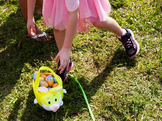 A girl picks up her egg basket at the 22nd Annual Royal Scoop Easter Egg Hunt and Games in Bonita Springs on Saturday March 26th, 2016. (Logan Newell/Special to the Daily News)
