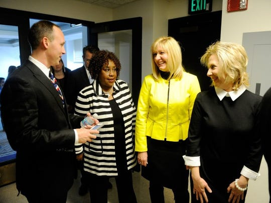MIKE LAWRENCE / COURIER & PRESS Newly elected members of the Evansville City Council (L-R) Jonathan Weaver, Connie Robinson, Missy Mosby and Michelle Mercer talk while waiting for the elevator to take them to the stage at the Victory Theatre for Friday's swearing in ceremony, January 1, 2016.