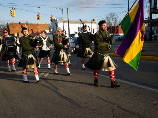 DANIEL R. PATMORE / SPECIAL TO THE COURIER & PRESS   Hadi Highlanders Drum and Bagpipes core march in the Mardi Gras Parade Saturday afternoon Feb. 14, 2015 on Franklin Street in Evansville, Indiana.