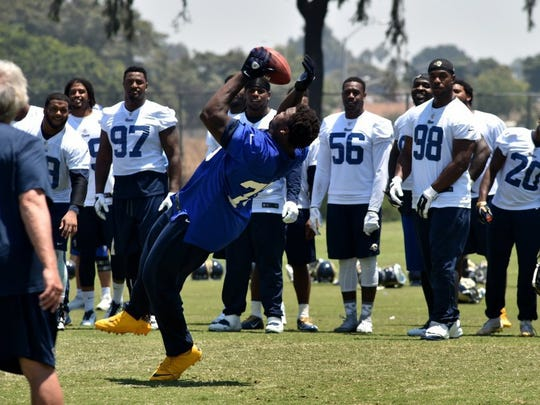 Greg Robinson participates in a punt-catching challenge