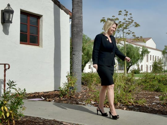 Erika Beck, the new president of CSU Channel Islands, walks through campus Monday after meeting with a group of student leaders during her first day on the job.