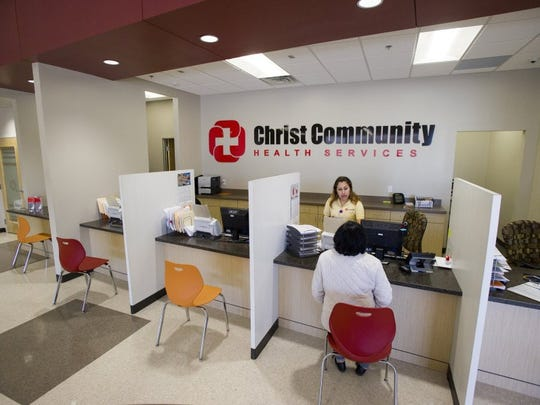 Maria Jimenez (standing) helps a patient check in Feb. 3, 2016 at the newly opened Christ Community Health Services clinic in Raleigh.