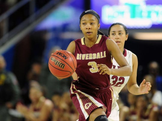 Riverdale's Anastasia Hayes (3), charges down the court