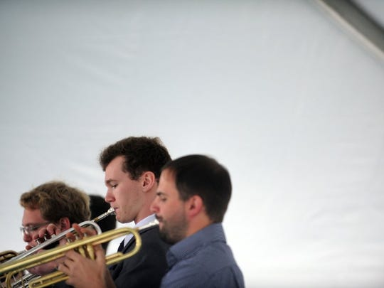 Trumpeters of the UT Jazz Big Band, play at the Rossini Festival in downtown Knoxville on Saturday, April 23, 2016.