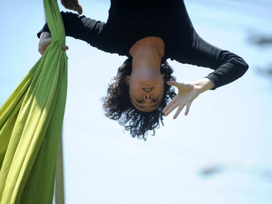 Katlyn Gagnier of Knoxville, performs as part of Dragonfly Aerial Arts Studio during Vestival, located at the Candoro Marble Building in South Knoxville on Saturday, May 7, 2016.