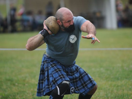 An athlete participates in the stone put at the Smoky Mountain Scottish Festival & Games at Maryville College on Saturday, May 21, 2016.
