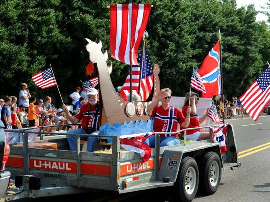 The Sons of Sweden float participates in the Town of