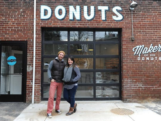 Sara and Sean Alsobrooks stand outside their shop Makers Donuts, which opened in January 2016 at 804 Tyson St. and closed a little more than two years later.