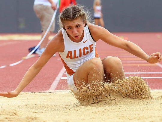 GABE HERNANDEZ/CALLER-TIMES Alice's Criselda Cruz competes in the triple jump during the Region IV-5A Track & Field Meet Friday in San Antonio.