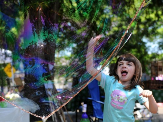 Libby Bradley, 6, of Knoxville, plays with a bubble during Vestival, located at the Candoro Marble Building in South Knoxville, in May 2016.