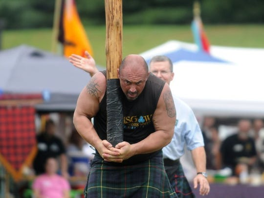 An athlete participates in the caber toss at the Smoky Mountain Scottish Festival & Games at Maryville College on Saturday, May 21, 2016.