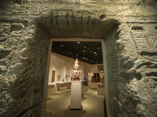 "A plaster cast of Ramesses II greets visitors to ""Ancient"