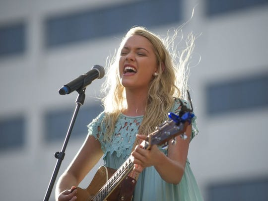 Emily Ann Roberts, last year's CTE Live winner, opens with a performance before the 2016 show in Market Square. (CAITIE MCMEKIN/NEWS SENTINEL)