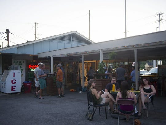 Patrons hangout at Bearden Beer Market, located off of Kingston Pike on Tuesday, June 7, 2016.