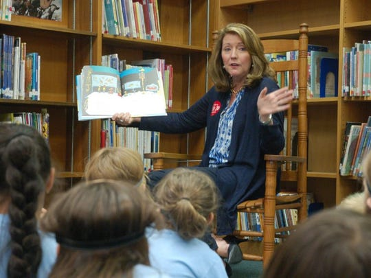 "Tennessee's first lady, Crissy Haslam, reads to students in Oak Ridge's summertime ""Read to be Ready"" program at Glenwood Elementary School on Thursday morning as part of her yearslong effort to improve children's reading skills. (BOB FOWLER/NEWS SENTINEL)"