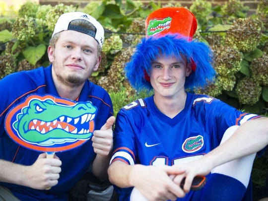 Brothers Cody and Robert Schommer of Loudon show their gator pride at ESPN College Game Day next to Ayres Hall at University of Tennessee on Saturday, Sept. 24, 2016.