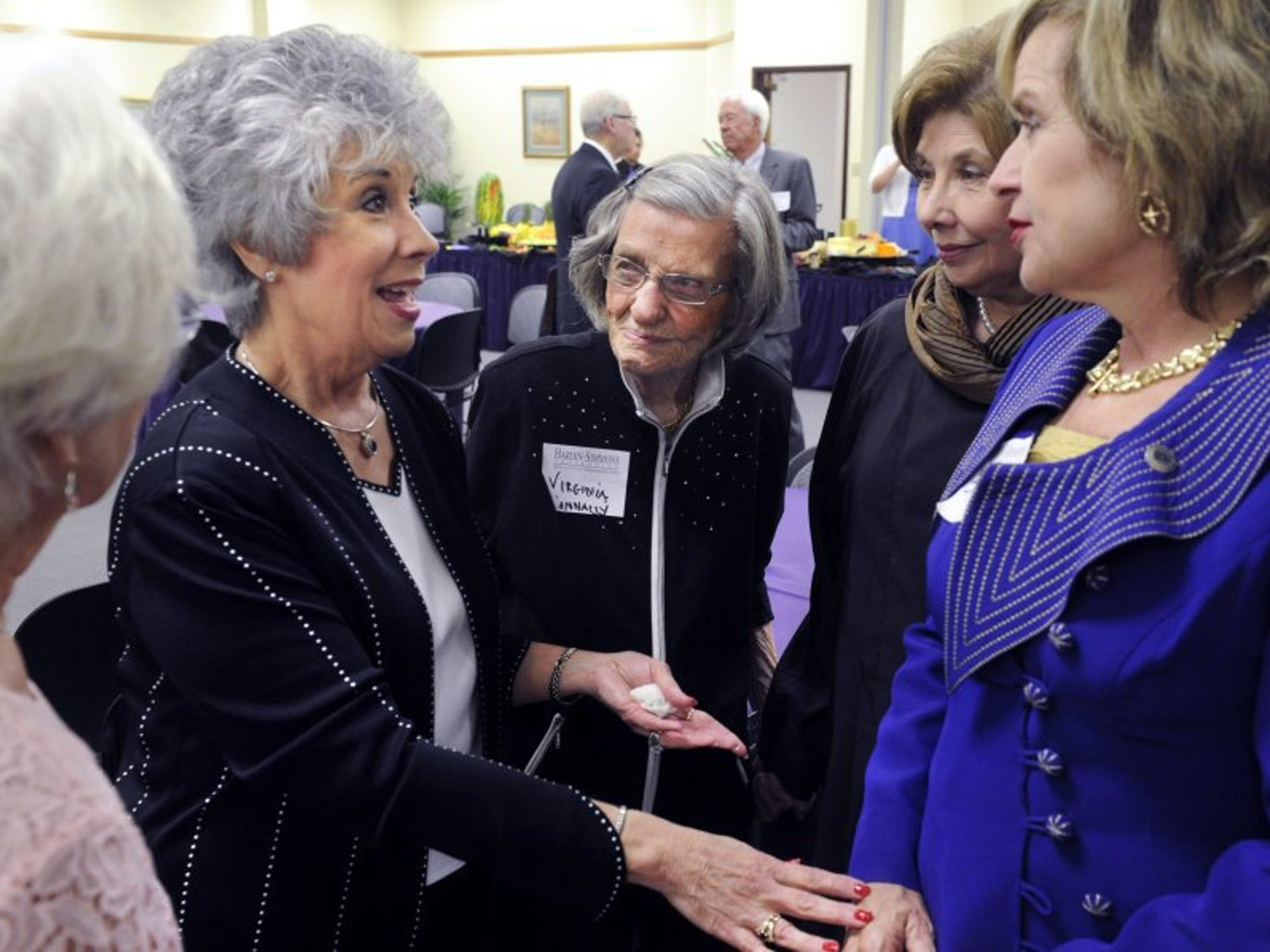 Dr. Virginia Connally, center, listens as Carol Hall speaks with then-District 71 state Rep. Susan King at a Lanny Hall farewell event on campus in 2016.