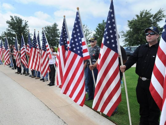 Nellie Doneva/Reporter-News People attend a Memorial Day ceremony at the Texas State Veterans Cemetery at Abilene Monday, May 30, 2016.