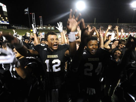 Thomas Metthe/Reporter-News Abilene High players celebrate the Eagles' 55-38 win over Cooper in the crosstown football game on Friday, Sept. 9, 2016, at Shotwell Stadium.